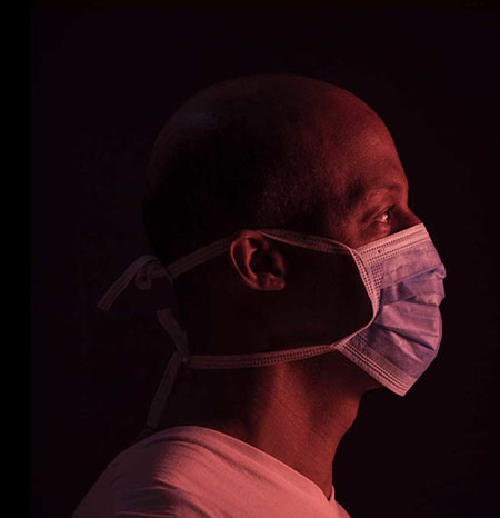 Black man wearing mask during COVID-19 pandemic